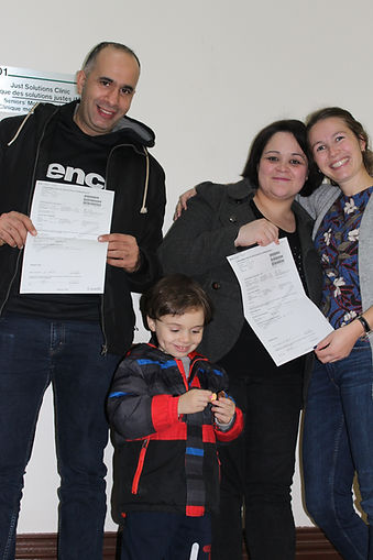 Legal Clinics Caseworker Louise Olivier with Client Family