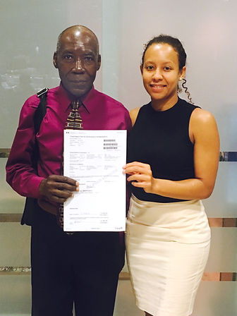Legal Clinics Coordinator Olga Houde with Client