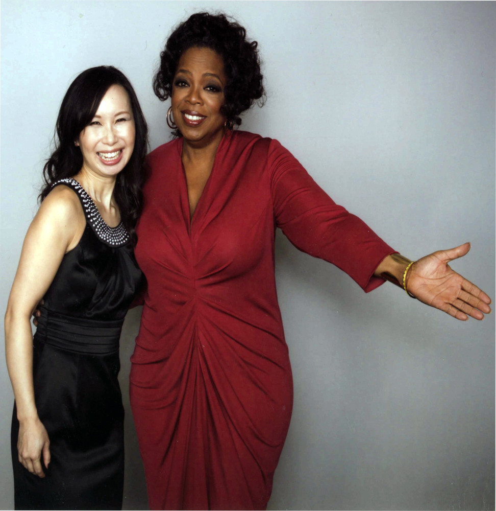 Oprah Winfrey sharing a laugh with jennifer