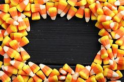 Halloween Candy Corns On Black Wooden Ba