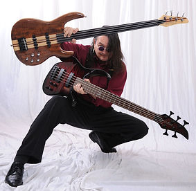 Kevin Village-Stone and custom Carvin basses