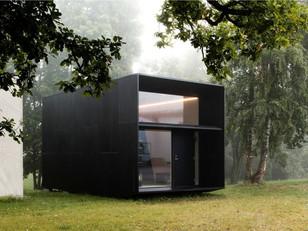 Pequena casa de aço e madeira com interior espetacular