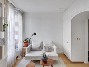 Tons neutros tornam esse apartamento agradável e charmoso