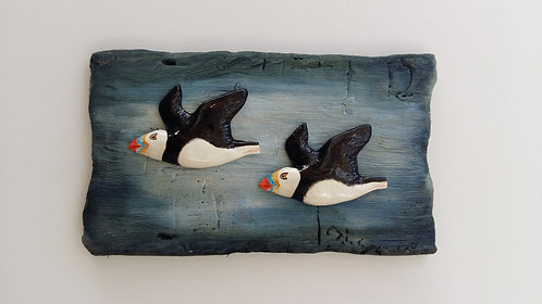 Two flying puffins