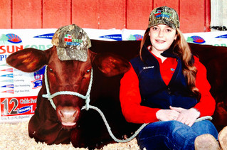 SUNCOAST Bedding Proud to Sponsor Calf Scrambler, Whitney with her heifer, Lois Lane.