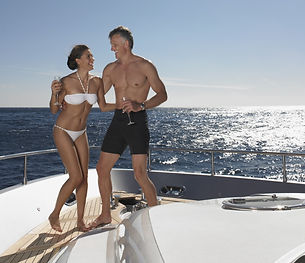 Playful couple enjoying on yacht against