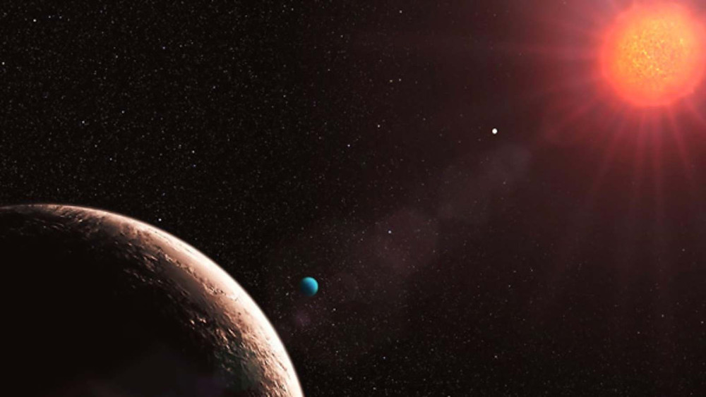 An artist's impression of Gliese 581; the smaller blue object is a super Earth some eight times the size of our planet.