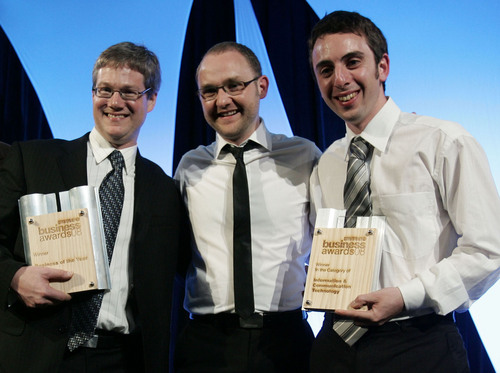Atlassian's Soren Harner (centre) with colleagues