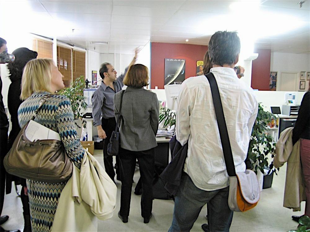 Wilson da Silva (centre) shows ASC members of  through the COSMOS production process