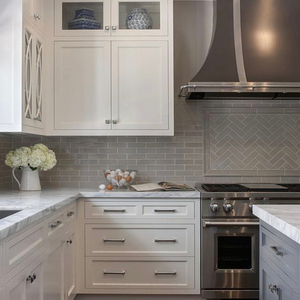Understated Elegance  Simplicity and clever detail team up to deliver understated elegance in this foundation kitchen. Soft whites and muted greys are king, so we added herringbone tile and feature cabinet doors for the one-two punch of style and personality.