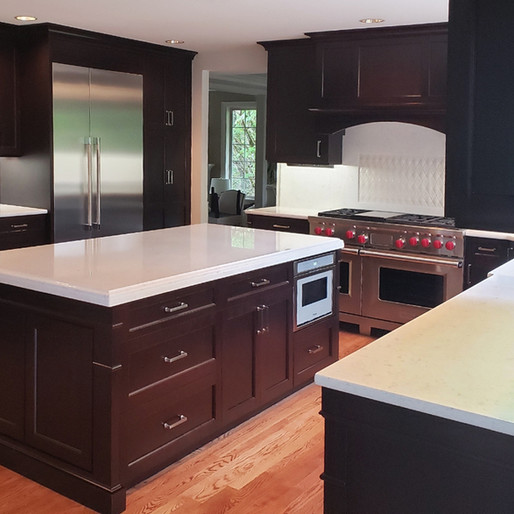 Traditional  Sleek form, bold profiles, warm tones. This traditional, high-contrast kitchen, boasting professional-grade appliances, says dull is out and big family dinners are in.