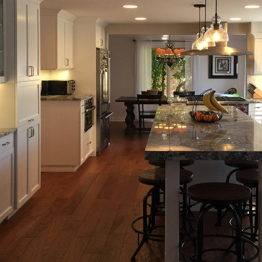 Family  Destined to be a favorite gathering spot, an island table was our recommendation as the focal point of this family kitchen. It's a 21st-century take on the traditional breakfast bar. New lift-up cabinet doors offer one-handle access to multipurpose storage spaces.