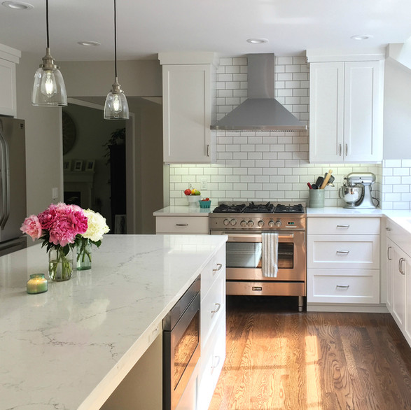 Urban  In this stunning white-on-white kitchen, we incorporated a stainless chimney hood and a subway tile feature wall. Its urban vibe is fresh and bright for on-point city living.