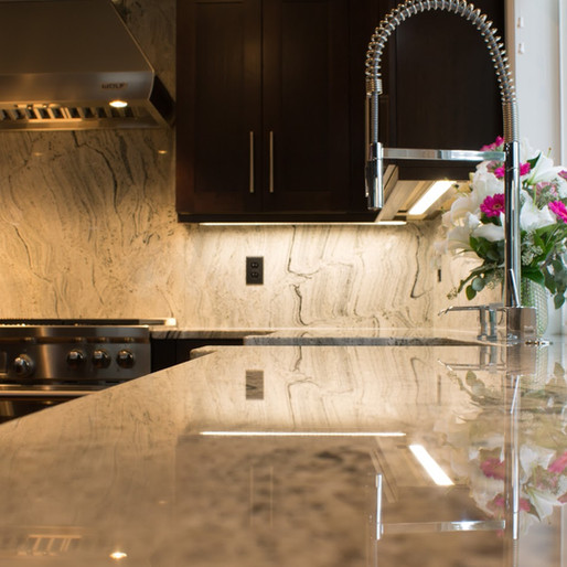 The Sophisticate  Gorgeous granite is the eye-candy centerpiece of this compelling kitchen. Adding the rich warmth of dark cabinets allowed us to create a hub that is entirely sophisticated, and yet still invites loved ones to relax and recharge.