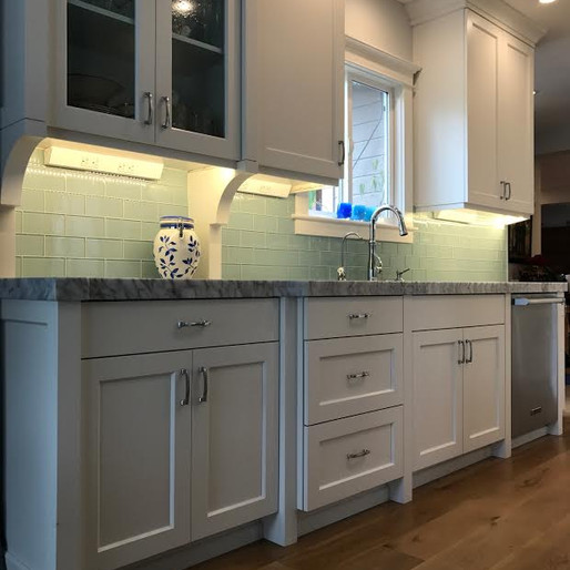 Vintage  Clean and pretty, this vintage kitchen pays homage to the timeless colors and lines we love. We made it modern with state-of-the-art appliances, hidden cabinet functionality and thick slabs of stone.