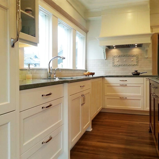 Antique  Classic with a twist — in this kitchen we have woven antique and up-to-the-minute together, for a look that honors the original details of the house. Integrated appliances minimize visual clutter so that the special tile detail can shine.