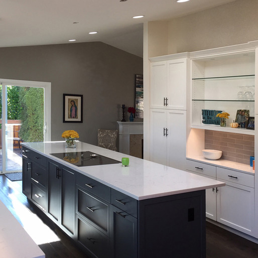 Contemporary Color Block  Color block cabinetry (in two tones) draws the eye to the island in the center of this thoroughly contemporary kitchen. We chose accent wall cabinets that match the starkly contrasting marble countertop — cool, crisp and very 21st-century.