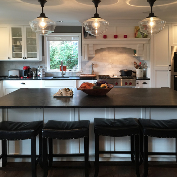 Farmhouse  Comfortable and appealing, this farmhouse kitchen is large yet intimate, stylishly old fashioned and decidedly trendsetting. We've made it the perfect family-friendly space with easy clean-up surfaces.