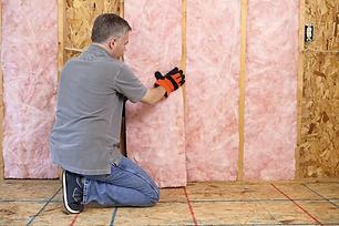man-installing-insulation-182186960-583d