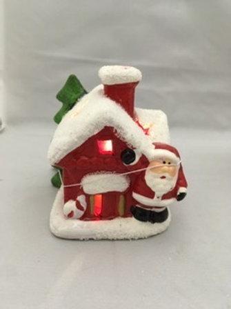Light up ceramic santa house