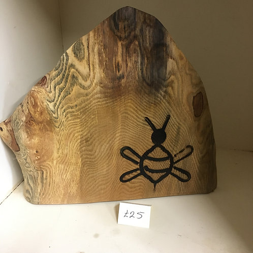 Wood piece with burned bee