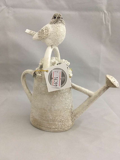 Sparkly bird on watering can