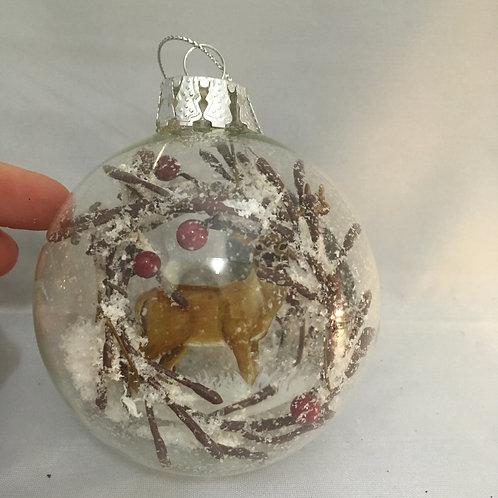 Reindeer in snow circular bauble