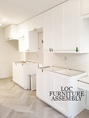 IKEA kitchen with matte white finish and custom desk