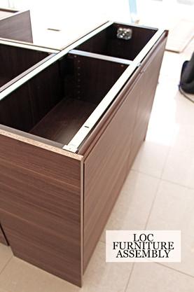 IKEA kitchen with brown wood grain finish island