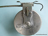 G E S vintage side-cast fishing reel metal back plate image