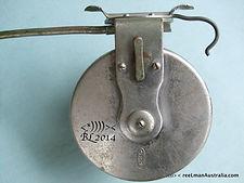 G E S vintage side-cast fishing reel metal back plate image