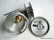 CLASMI early twin handle-knob fishing reel internal view showing the removable threaded side plate; gearing; felt back lash-brake.