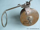 G E S vintage side-cast wood fishing reel back plate image