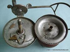 Vintage G E S wood & metal side-cast reel internal mechanism image