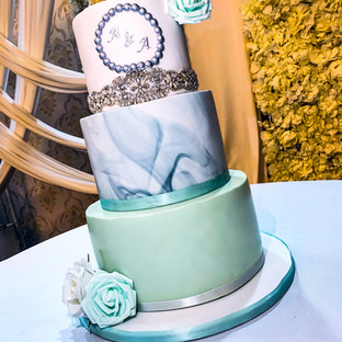 Marble Wedding Cake with Diamond Broche.