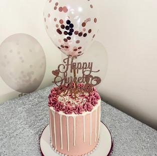 Pink drip cake.