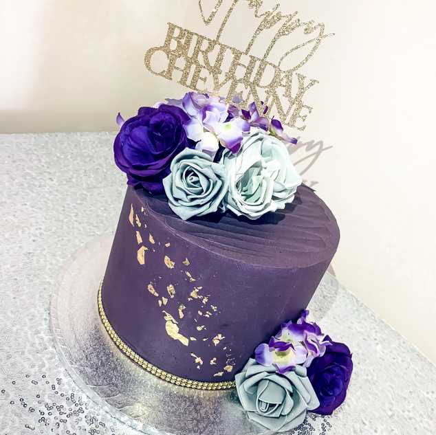 A Purple and grey buttercream cake. With added gold touches.
