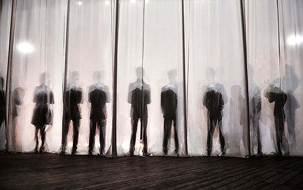 _the silhouette of the men behind the cu