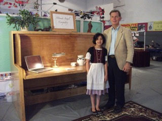 Founder and daughter showing their first Hiddenbed at trade show in 2011
