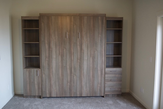 Simple wall bed with optional cabinets