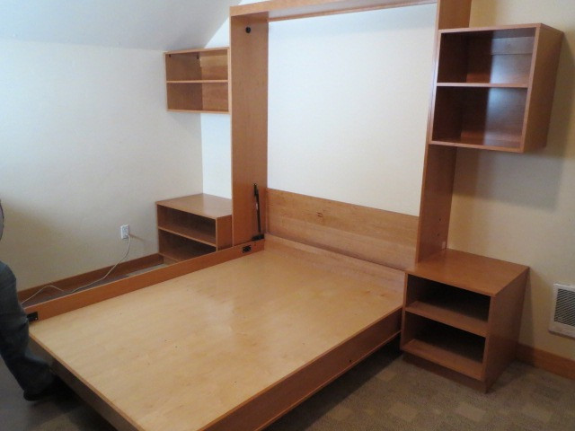 Simple wall bed with custom cabinets in cherry