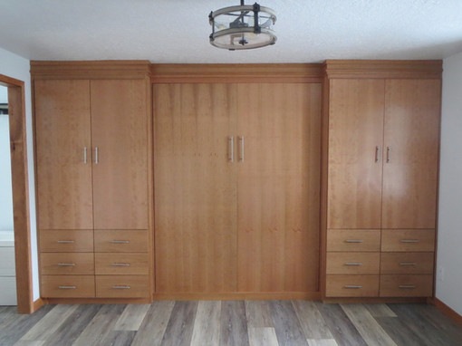 Simple wall bed with optional cabinetry in cherry