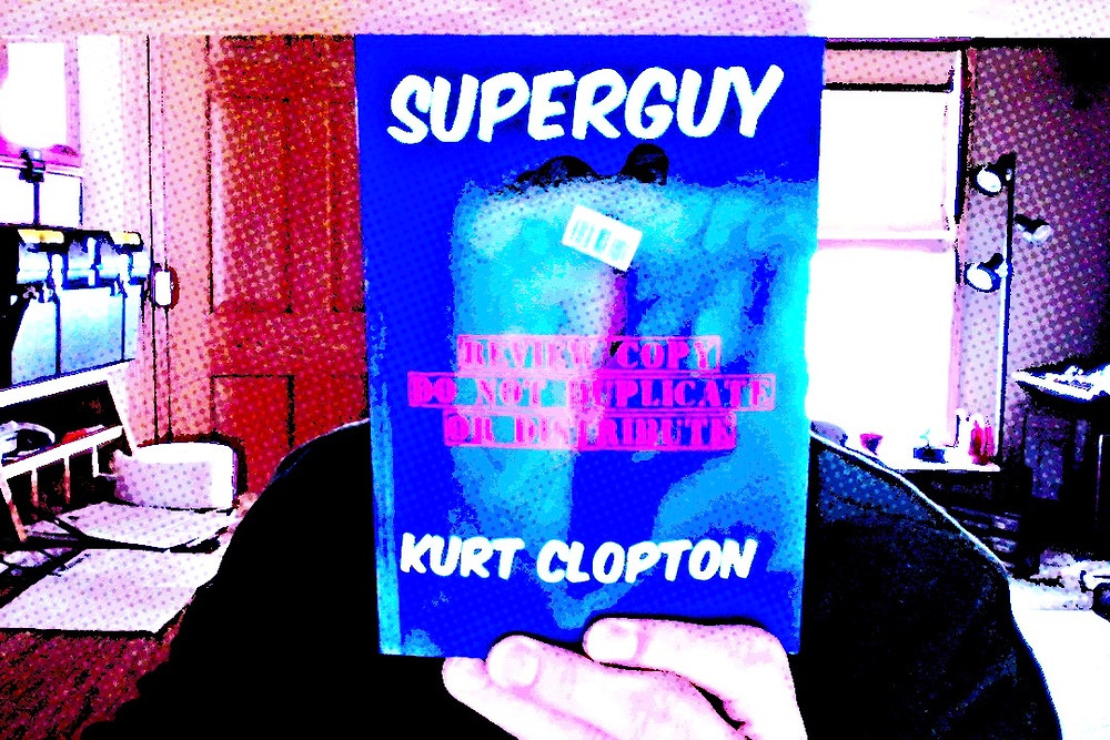 Photo of the cover of the review copy of my book, SuperGuy.
