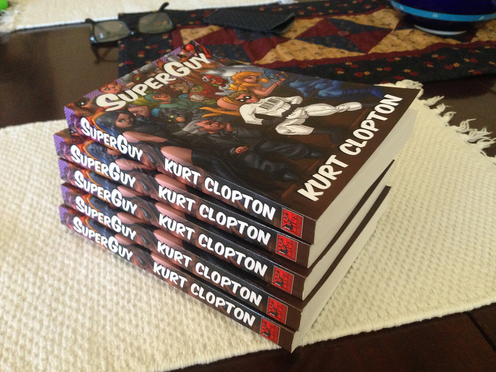 Stack of five copies of SuperGuy book