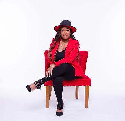 Solo red blazer sitting photo.jpg