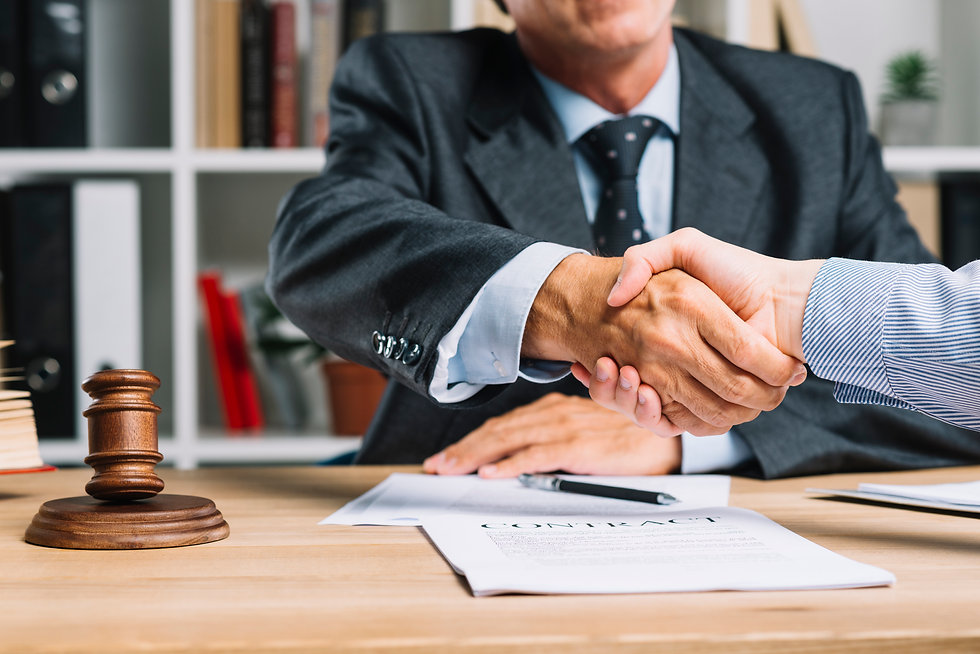 lawyer-and-his-client-shaking-hands-toge