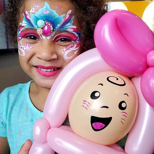 Princess face painting and a baby balloon twisting
