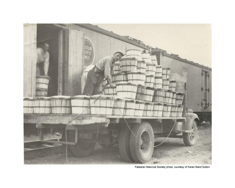 Mr Baird loading bushels into box car