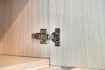 Cabinet door hinges in a cupboard close-