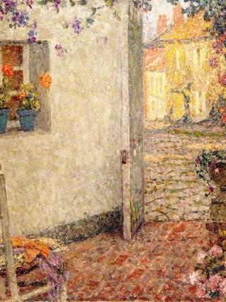 L'entrée de la maison et l'atelier